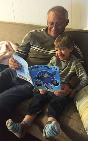 Author Paul J. Mila reading with his grandson, Max